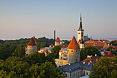 Elevated view of lower Old Town with Oleviste Church in the background, UNESCO World Heritage Site, Tallinn, Estonia, Europe