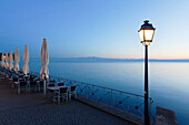Street cafe on a promenade at sunset, Meersburg, Lake Constance (Bodensee), Baden Wurttemberg, Germany, Europe