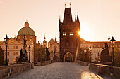 Old Town Bridge Tower and Charles Bridge at sunrise, UNESCO World Heritage Site, Prague, Bohemia, Czech Republic, Europe