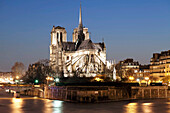 Notre Dame cathedral and River Seine at night, Paris, Ile de France, France, Europe