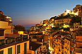 Riomaggiore rooftops and the Castle at dusk, Cinque Terre, UNESCO World Heritage Site, Liguria, Italy, Mediterranean, Europe