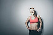 Portrait of smiling Caucasian woman in sports-bra, Saint Louis, Missouri, USA