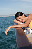 Caucasian woman relaxing on sailboat, Cape Town, Western Cape, South Africa