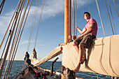 Caucasian man relaxing on sailboat, Cape Town, Western Cape, South Africa