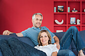 Couple relaxing together in living room, Palma de Mallorca, Balearic Islands, Spain