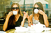 Women having coffee together at sidewalk cafe, Ekaterinburg, Swerdlovsk, Russia