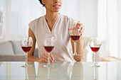 Black woman tasting wine, Jersey City, New Jersey, USA
