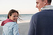 Caucasian couple walking on beach, Cape Town, Western Cape, South Africa