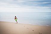 Mixed race boy playing on beach, Sayulita, Nayarit, Mexico