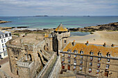 France, Brittany, Saint Malo, partial view of the castle with its tower and the small donjon, city hall on the right.