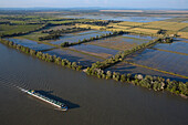 France, Bouches-du-Rhône (13) Barge on Rhone landscape of salt marshes of vineyards and agricultural fields (aerial photo)