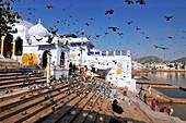 Gaths at Holy Pushkar Lake and old Rajput Palaces. Pushkar. India.