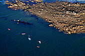 aerial view of several boats moored along a rocky Advanced
