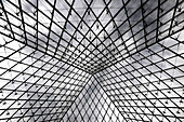 France. Detail of the structure of the glass pyramid of the Louvre in Paris
