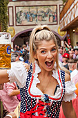 Germany, Baveria, Munich, Oktoberfest, Young Woman Drinking Beer