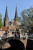 Netherlands, Delft, Bridge and bike in front of the est door that is the last remains of the walls of the city