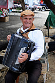 Man playing the accordion in Gozo island, a small island of the Maltese archipelago in the Mediterranean Sea, Europe