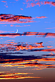 Seine et Marne. Provins. Clouds twilight. Crescent moon emerging from clouds. Airplane.