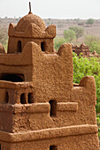 'Central Niger, Close up view of one of corner towers of Yaama mud brick mosque. Built 1962-1982 by Master builder El Hadji Falke Barmou using in a creative manner traditional mud brick techniques from Tahoa Region; Yaama Village'