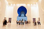 'The entrance of Sheikh Zayed Grand Mosque at night; Abu Dhabi, United Arab Emirates'