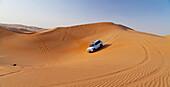 'Four wheel driving in the desert; Liwa Oasis, Abu Dhabi, United Arab Emirates '