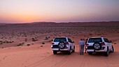 'Four wheel drive vehicles in the desert; Liwa Oasis, Abu Dhabi, United Arab Emirates '