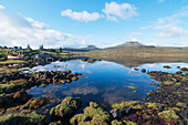 'Landscape of shoreline and tranquil water of the Isle of Skye; Skye, Scotland'