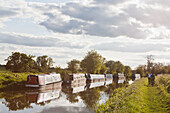 'Cycling along path next to Kennet and Avon Canal; Great Bedwyn, Wiltshire, England'