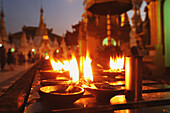 'Oil candles at Shwedagon Pagoda; Yangon, Burma'