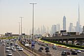 'Looking along Sheikh Zayed road towards the business district and Burj Khalifa; Dubai, United Arab Emirates'