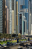 'Apartment and office buildings lining Sheikh Zayed Road; Dubai, United Arab Emirates'