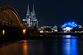 'Hohenzollern Bridge and Cologne Cathedral at nighttime; Cologne, Germany'