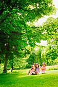 Four Girls Sitting On Lawn