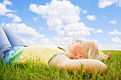 Girl Resting On The Grass