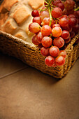 A Close-Up Of Grapes And Bread