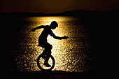 Silhouette Of Unicycle