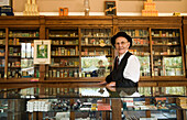 Man In An Old Fashioned Pharmacy