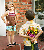 Boy Presenting Girl With Bouquet