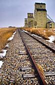 Grain Elevators Along Train Tacks, Alberta, Canada