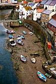 Boats Beached On The Riverbank, Staithes, North Yorkshire, England