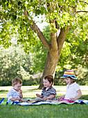 Three Children Sitting Under A Tree