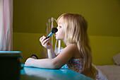 Girl Playing With Make Up Brush