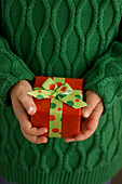 Child's Hands Holding A Present