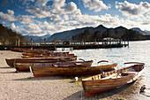'Lake District, Cumbria, England; Rowboats On Shore'