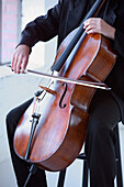 A Person Playing A Cello