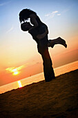 'A Man And Woman Together On A Beach In A Sunset; St. Catherine's, Ontario, Canada'