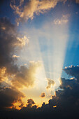 Rays Of Light Shining Through The Clouds