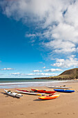 'Coldingham, Scottish Borders, Scotland; Kayaks Sitting On The Sand At The Shore'