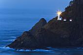 'Oregon, United States Of America; Heceta Head Lighthouse At Sunset'