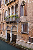 'Venice, Italy; Front Of A Palace Along A Canal'